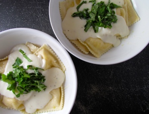 Fresh ravioli with basil white béchamel and nutmeg